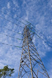 Clouds and electric towers Stock Photos