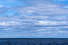 Clouds, empty sea shore Stock Photography
