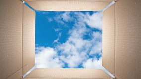 Clouds are fast moving in the blue sky from inside of a cardboard box. TimeLapse. Clouds are fast moving in the blue sky from inside of a cardboard box stock footage