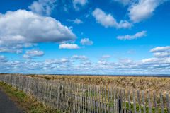 Clouds and Fence stock images