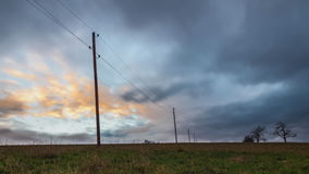 Clouds on a field with electrical power supply stock video