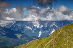 Cloud with flat base covers peaks of Sexten Dolomites, Italy Stock Photos