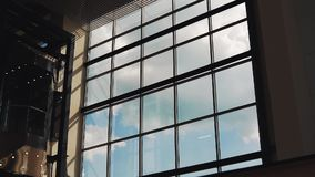 Clouds float outside the window buildings Time lapse stock video