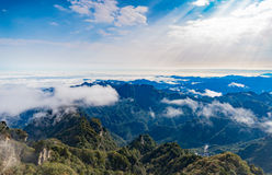 Clouds float over the mountains Royalty Free Stock Image