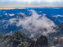 Clouds float over the mountains.  Royalty Free Stock Images