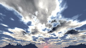 Clouds float towards the setting sun stock footage