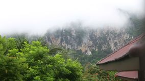 Clouds float of tropical mountains. In Thailand stock video footage