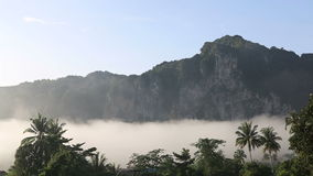 Clouds float of tropical mountains stock footage