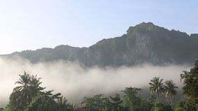 Clouds float of tropical mountains stock video
