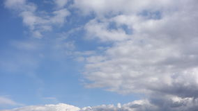 Clouds floating in the sky. Fast floating on the blue sky clouds stock video