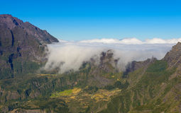 Clouds flowing above mountains in the Mafate cirque, La Reunion Royalty Free Stock Images