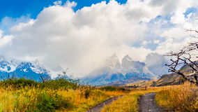 Clouds flowing over Cuernos del Paine at Lake Pehoe stock footage