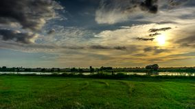 Clouds flowing in the sky at sunset over the Vistula river. stock video