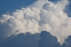 Clouds. Fluffy blue clouds on a cloudy day Royalty Free Stock Photo