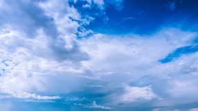 Clouds fly across the sky. Very high Wite Clouds fly across the blue sky at sunny day Stock Photos