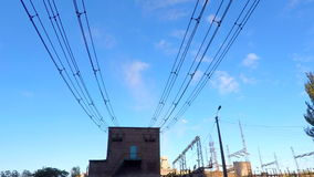 The clouds fly over the power substation Time lapse stock video footage