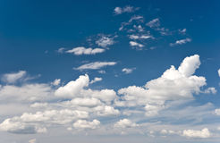 Clouds and flying airplane stock image