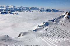 Clouds and fog above, winter landscape in the Alps Royalty Free Stock Photography