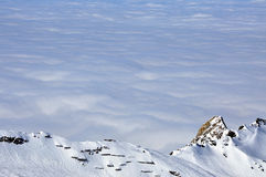 Clouds and fog above, winter landscape in the Alps Stock Images