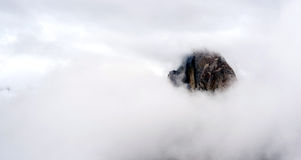 Clouds and Fog Move in Covering Half Dome Yosemite Royalty Free Stock Images