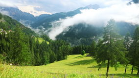 Clouds and Fog over the Mountainous Rural Valley. Fast Motion. Summer Austrian alps. Morning mist and clouds over the rural valley. Fast motion stock footage