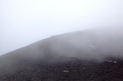 Clouds and fog on Silvestri crater of Etna volcano. Royalty Free Stock Photography