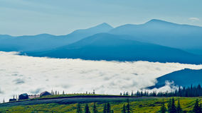 Clouds at the foot of the mountains Royalty Free Stock Photo