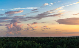 Clouds on forest horizon. Royalty Free Stock Images