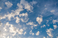 Clouds in the form of bizarre shapes on a blue sky Royalty Free Stock Photos