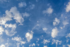 Clouds in the form of bizarre shapes on a blue sky Royalty Free Stock Image