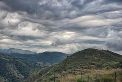 Clouds form into wave like patterns in the Spanish sky. (Asperitas) Stock Photography