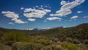 Clouds Formation above Snow Mountains by the River. Time Lapse Clouds Formation above Snow Mountains by the River stock footage