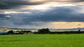 Clouds formation over farms and distance hills royalty free stock photo