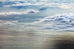 Colorful sunrise over the Atlantic Ocean seen from Pico Volcano. Clouds formation at sunrise over the Atlantic Ocean, seen from Pico volcano 2351m, Pico Island Royalty Free Stock Photo