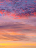 Clouds with full colour sunset sky Stock Photography