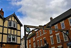 Clouds gather over The Green Man and Black`s Head Royal Hotel, in Ashbourne, Derbyshire. Taken to capture a sense of the rich pastoral and antiquated English stock photography