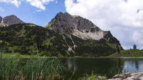 Clouds at the Geisalpsee in a timelapse. Clouds at the Geisalpsee in the Allgäuer Alps in a timelapse movie stock video footage