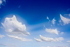 Clouds-ghost. Funny clouds ghost in the blue sky - surreal effect inspired at cartoons Stock Photo