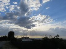 Paesaggio. The clouds give shapes, each time different, to the sky with their continuous movement royalty free stock photos