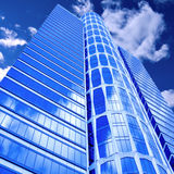 Clouds in glazed panel skyscraper Royalty Free Stock Image