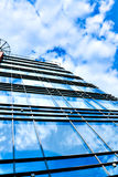 Clouds in glazed panel skyscraper Royalty Free Stock Photos