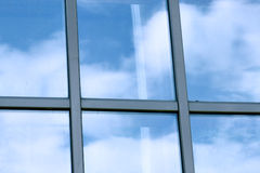 Clouds in glazed panel skyscraper Royalty Free Stock Images