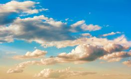 Clouds of golden hue. Mysterious beautiful clouds with a golden hue stock photography