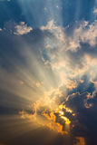 Clouds and golden sunbeam Stock Photography