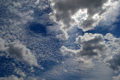 Clouds of good weather. Islands of clouds on the blue sky hovering over the Danube islands stock photography