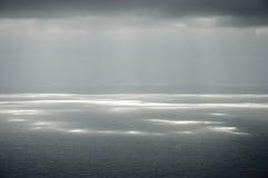 clouds grått solsken arkivfoto
