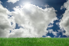 Clouds and grass background. Beautiful clouds and sky with green grass Stock Photo