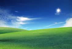 Clouds and a green field royalty free stock images