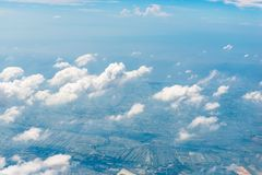 Clouds and green land photographed. From an airplane stock photo