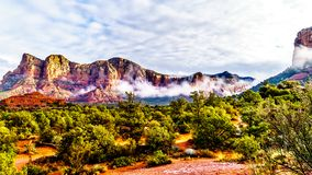 Clouds hanging around Lee Mountain and other red rock mountains surrounding the town of Sedona, Arizona stock photos